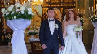 bride and groom go out of the church