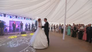 bride and groom share their first dance together on their wedding day.
