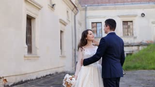 bride embrace on a background of an old house