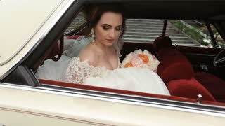 Bride in the car before the wedding