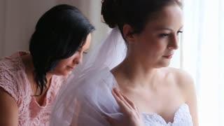 Bride preparing for dressing dresses