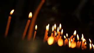 Burning candles. A lot of candles are burning on a candlestick.