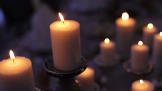 burning candles on old wrought-iron candlestick