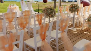 chairs at a wedding tent by the sea