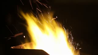 Close up of furnace in blacksmith workshop with flames in slow motion