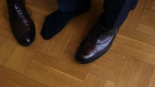Close up of groom wedding shoes