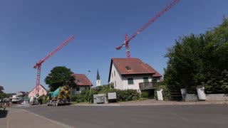 construction cranes on the background private houses