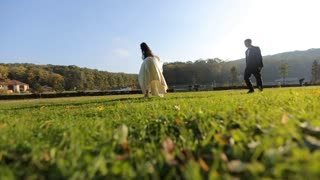 Couple in love walking at the field