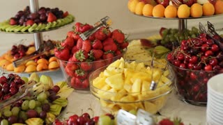 decorative fruit sliced on the buffet table at a wedding Stock Video ...