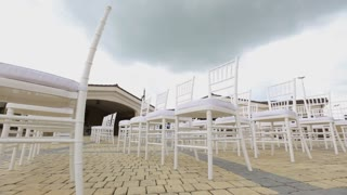 Dolly of rows of chairs at a wedding ceremony from the aisle and from the back