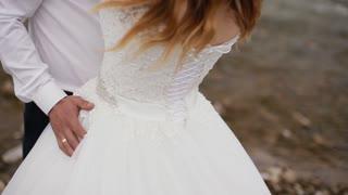 Groom keeping the waist of bride