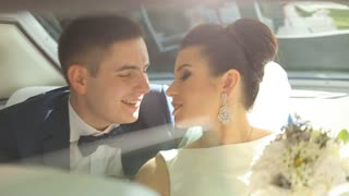 Happy Newlyweds Having Fun in a Limo