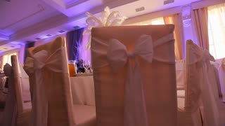 Interior of a wedding hall decoration ready for guests. Beautiful room for ceremonies and weddings. Wedding concept. Luxury stylish wedding reception purple decorations expensive hall. Wedding decor