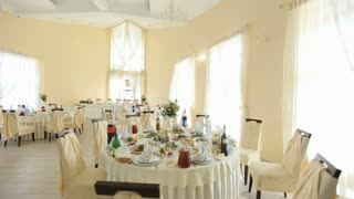 Interior of a wedding hall decoration ready for guests. Beautiful room for ceremonies and weddings. Wedding concept. Luxury stylish wedding reception purple decorations expensive hall