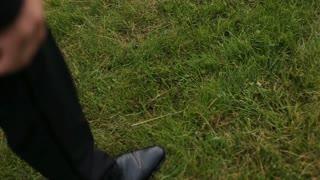 man walking on the grass