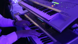 musician playing electronic piano in restaurant