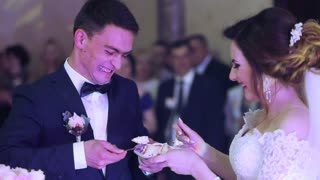 New young couple eat the cake