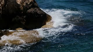 Sea waves beating the rock