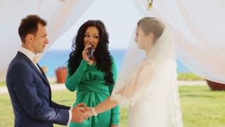Stylish happy smiling newlyweds on the luxury outdoor wedding ceremony