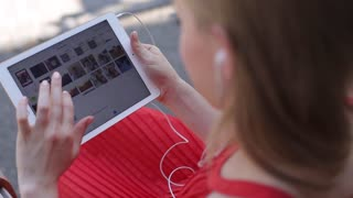 Teenager Girl Using Digital Tablet, Listening Music