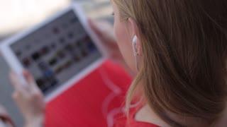 Teenager Girl Using Digital Tablet, Listening Music