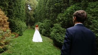 The groom follows redheaded bride