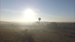 Aerial view of Hot air balloon drifting smoothly in the clear blue sky