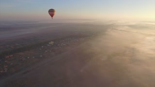 Aerial view of Hot air balloon floating in the pure blue sky on the sunrise