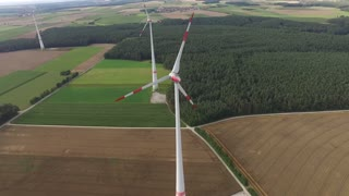 Aerial view of power generating wind turbines