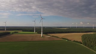 Aerial view of Wind turbines in the middle of the meadow