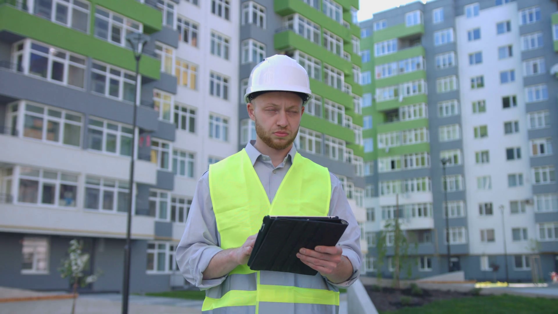 Builder engineer with white protected helmet and safety vest on construction  site using tablet for tapping something. Outdoor. Stock Video Footage -  Storyblocks