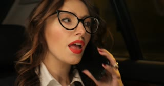 Close up of businesswoman in the backseat of car making a phone call
