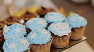 Close up shot of delicious cakes from the candy baar at a wedding hall. Dolly shot.