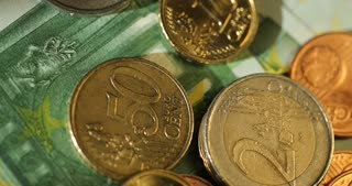 Close-up shot of Euro money, coins and banknotes. Euro currency. Coins stacked on each other in different positions. Money concept. Rotation