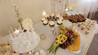 Close up view of colorful candy bar at a wedding hall. Dolly shot.