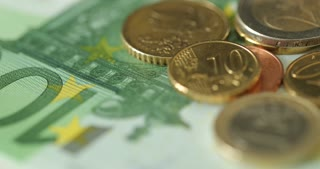 Euro Bills Spinning. Close Up Of Money. Euro currency. Coins stacked on each other in different positions. Money concept.