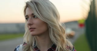 Portrait of beautiful young blond woman looking at camera
