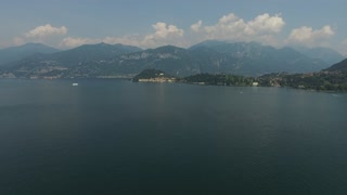 View of the harbor city located next to the mountains. Lake Como, Italy