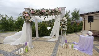 wedding arch decorated with flowers before the wedding ceremony in the sky background