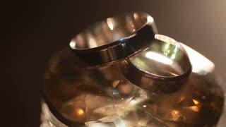 wedding rings on a rock crystal