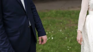 Young couple holding hands before the wedding. close-up