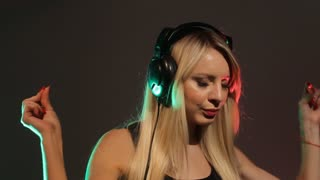 Young woman listening music through headphone slow motion