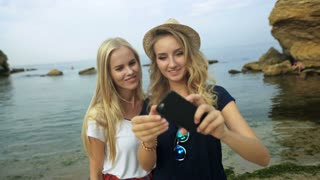 1. Two girls taking selfies.