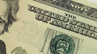 A macro dolly shot of a twenty dollar united states bill