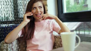 Adorable smiling woman talking on phone.