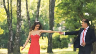 An elegant couple dancing in the park