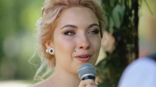 Beautiful blonde bride with nose ring taking vows at wedding ceremony