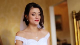 Beautiful bride feeling a bit sad before her bridesmaids made her smiling and happy.