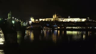 Beautiful Cityscape of Prague at night with Charles Bridge over Vltava river as foreground and Prague Castle in far distance, Czech Republic.