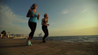 Beautiful slim attractive ladies running after work.
